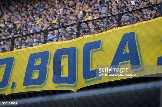 Picture of a banner of Argentine team Boca Juniors taken as fans wait for the start of the Argentina First Division Superliga football match against...