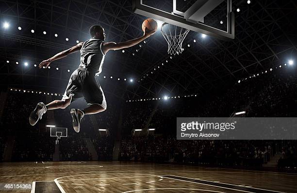 A picture of a basketball player dunking