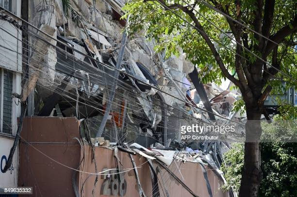 Picture of a building which collapsed after a quake rattled Mexico City on September 19 2017 A powerful earthquake shook Mexico City on Tuesday...