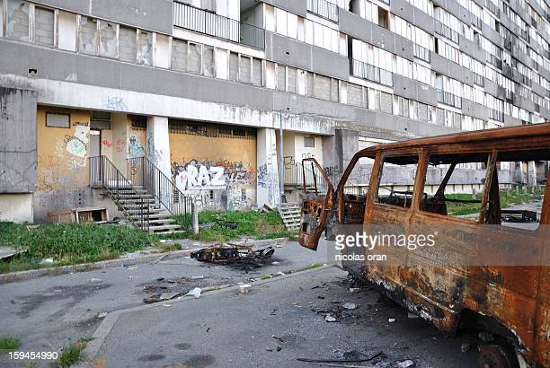 CONTENT] picture of a burned car taken in the ghetto of les bosquets in montfermeil paris's suburb