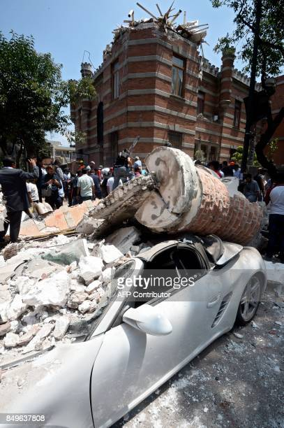 Picture of a car crushed by debris from a damaged building after a quake rattled Mexico City on September 19 2017 A powerful earthquake shook Mexico...
