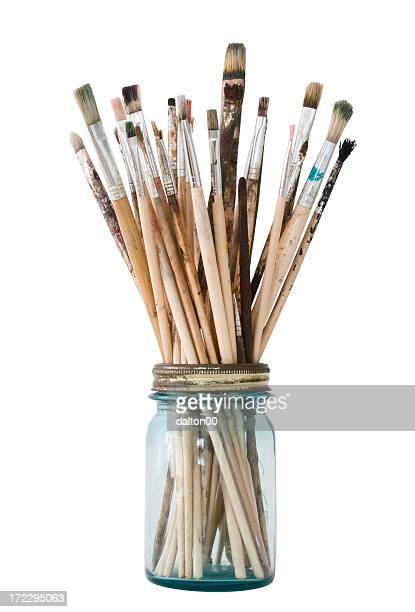 picture of a clear jar filled with paint brushes - paintbrush stock pictures, royalty-free photos & images