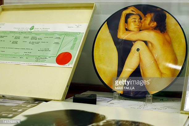 Picture of a copy of the marriage certificate of John Lennon and Yoko Ono and a CD of the couple on display at the Beatles museum in Buenos Aires...