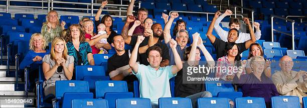 A picture of a crowd sitting in benches cheering