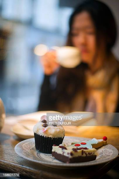 Picture of a cup cake a cranberry cake and a gingerbread man taken on December 20 2012 in Paris at the Sugarplum Cake Shop an authentic American...