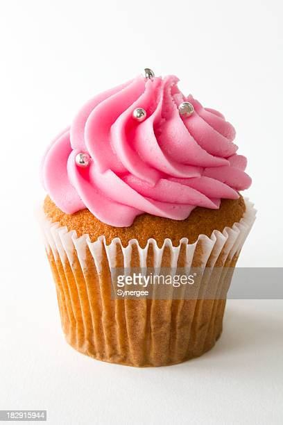 A picture of a cupcake with strawberry frosting
