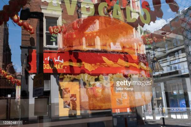 Picture of a delicious looking vegan burger in a fast food shop window on 26th June 2020 in London, United Kingdom. A veggie burger is a burger patty...