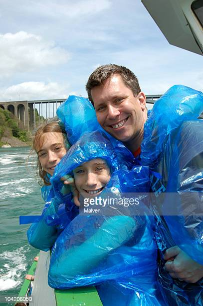 a picture of a father and his daughters on a boat - niagara falls stock pictures, royalty-free photos & images