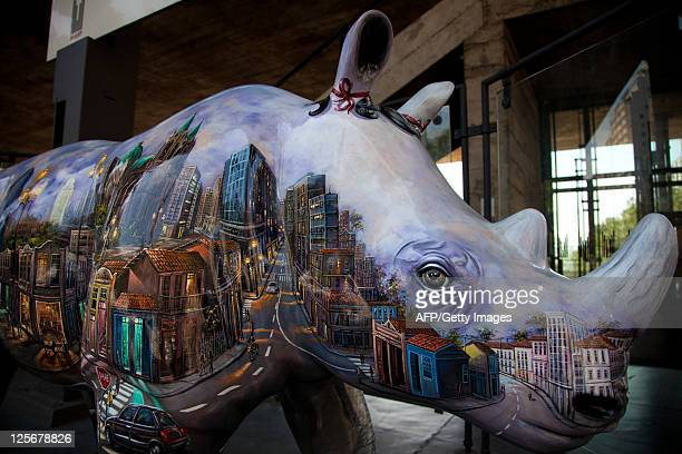 Picture of a fiberglassmade rhinoceros with a view of the city of Sao Paulo painted on it on display in front of the Art Museum of Sao Paulo as a...