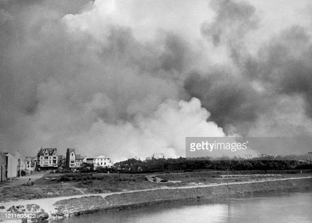 Picture of a fire at the oil tanks of Dunkirk set by the Allies before embarking to Great Britain during the Operation Dynamo on June 7 during the...
