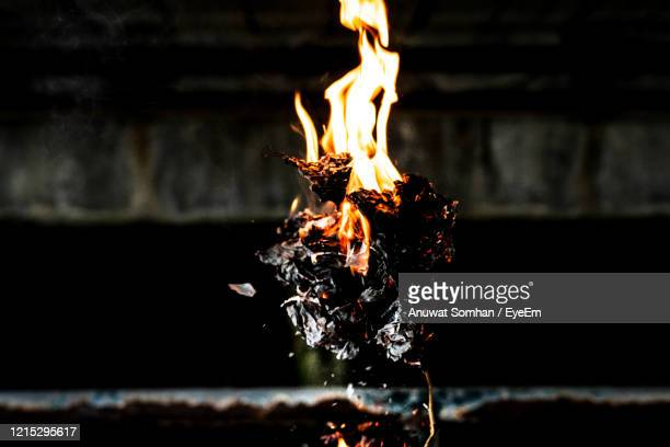 picture of a fire burning paper on the ground - burning stock pictures, royalty-free photos & images