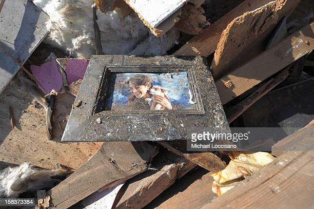 A picture of a girl and a dog lie in a pile of wreckage on December 14 2012 in Union Beach New Jersey The town is struggling to rebuild and recover...