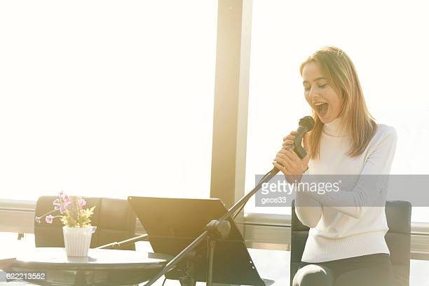 Picture of a girl holding a microphone