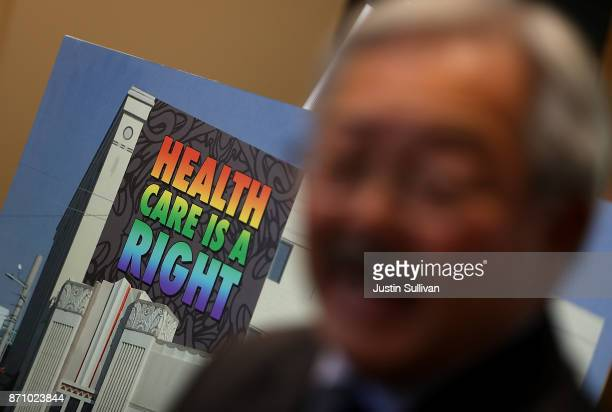 A picture of a healthcare mural is displayed as San Francisco mayor Ed Lee speaks during a news conference at HealthRIGHT 360 on November 6 2017 in...