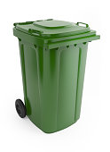 A picture of a large green rubbish bin with wheels on