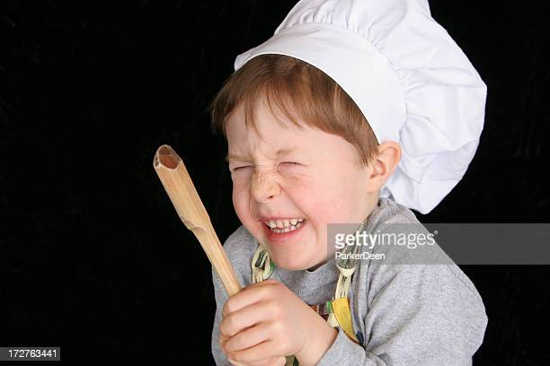 A picture of a little boy dressed as a chef
