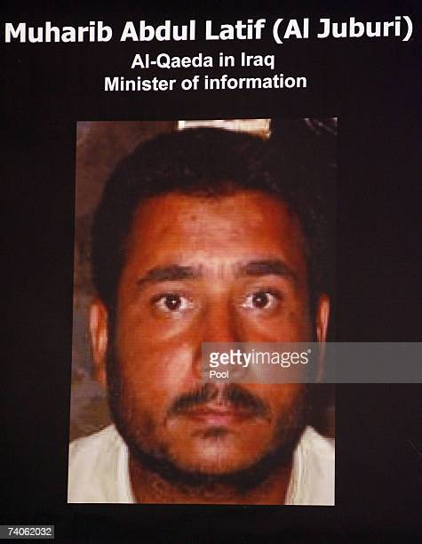 A picture of a man identified as Muharib Abdulatif alJuburi by the US military is displayed during a press conference May 3 2007 in Baghdad Iraq The...