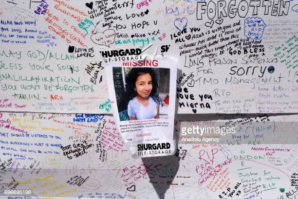 A picture of a missing person is seen on a messages of condolence which is written on a wall outside Latymer Community Church in London United...