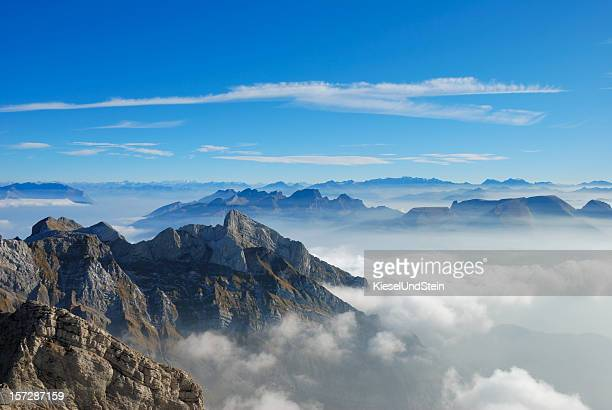 Picture of a mountain top from above the clouds