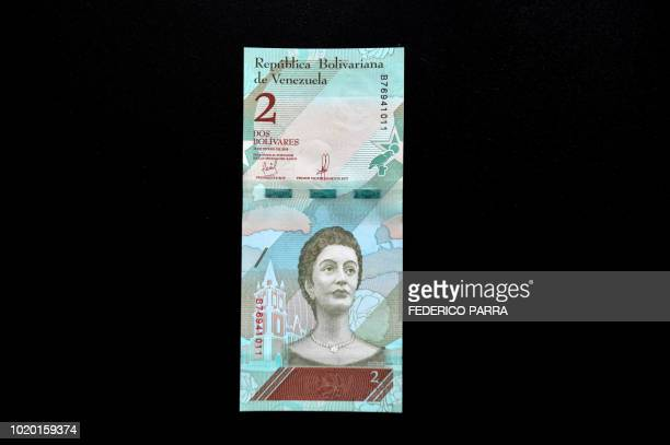 Picture of a new two Bolivar-note in Caracas on August 20, 2018. - Caracas is issuing new banknotes after lopping five zeroes off the crippled...
