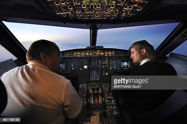 Picture of a pilot and woman copilot taken in a cockpit aboard an Air France Airbus A 320 during a special flight from Paris to Seville to attend the...