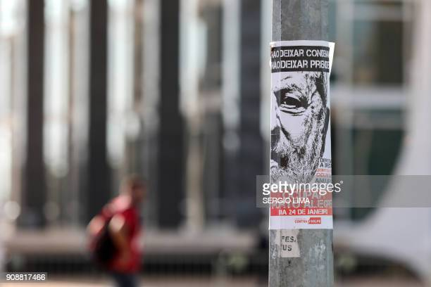 Picture of a poster placed at a bus stop in Brasilia on January 22 2018 in support of Brazilian former President Luiz Inacio Lula de Silva calling...