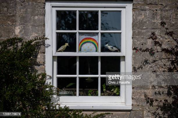 Picture of a rainbow and message thanking the NHS in a window of a cottage as Health Secretary, Matt Hancock, urged the public once more to follow...