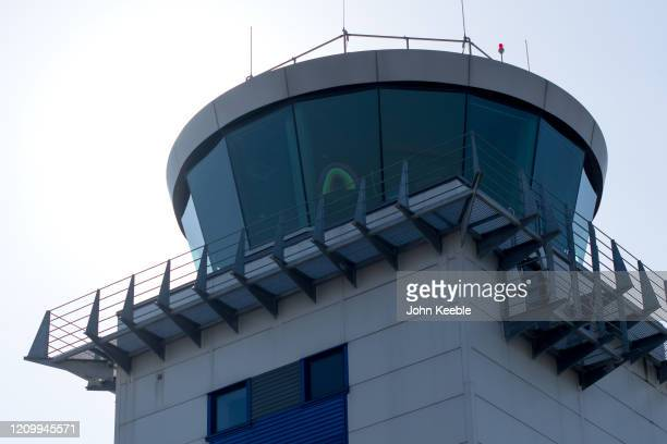 Picture of a rainbow is displayed in the window of the air traffic control tower at Southend Airport on April 14, 2020 in London, United Kingdom. The...