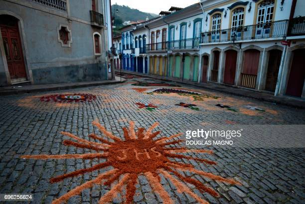 Picture of a sawdust carpet taken during the Catholic Corpus Christi celebration in a street of Ouro Preto, some 100 km from Belo Horizonte, Brazil,...