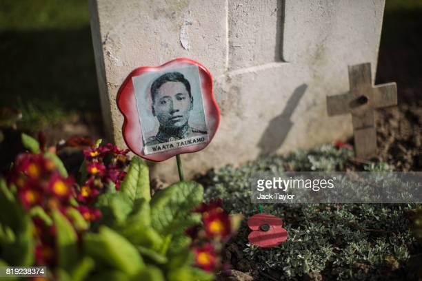 Picture of a soldier from the WW1 Maori Battalion sits in front of a headstone at the Ramparts Cemetery on April 6, 2017 in Ypres, Belgium. July 31st...