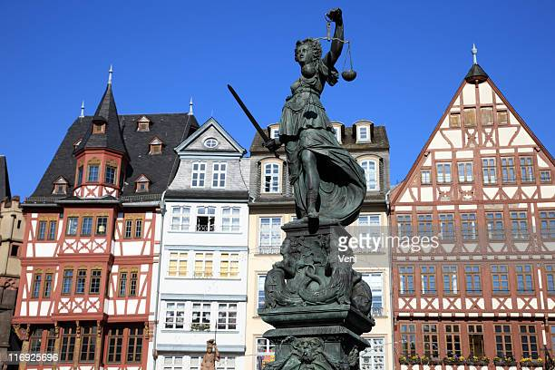 A picture of a statue of Re_merberg in Frankfurt, Germany