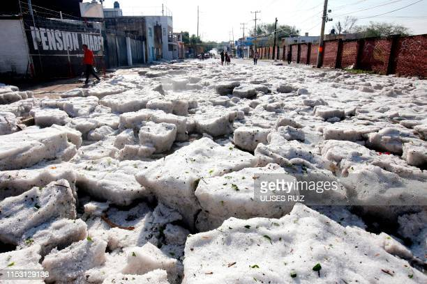 Picture of a street of Guadalajara, Jalisco State, Mexico, taken on June 30, 2019 after a hail storm fell in the area. - A freak hail storm on Sunday...