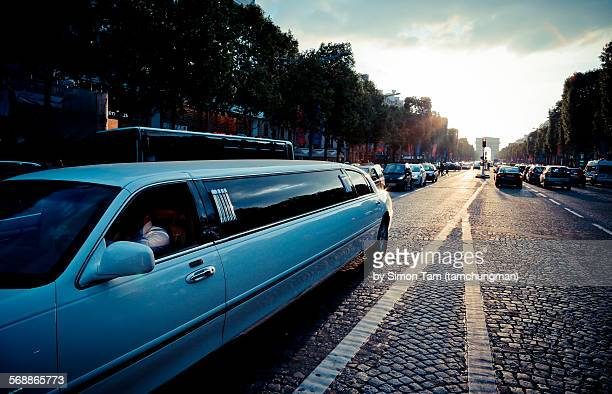 a picture of a street view in paris - limousine stock pictures, royalty-free photos & images