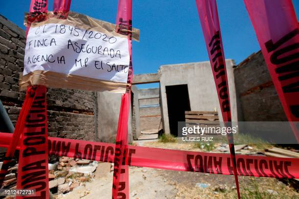 Picture of a taped-off unfinished construction at the farm where remains of at least 25 people were found buried in a clandestine mass grave in the...