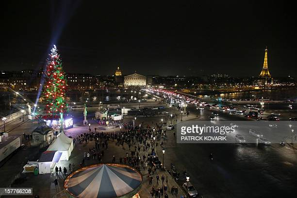 Picture of a view of a giant Christmas tree at the Concorde square in Paris taken on December 6 2012 AFP PHOTO / PATRICK KOVARIK