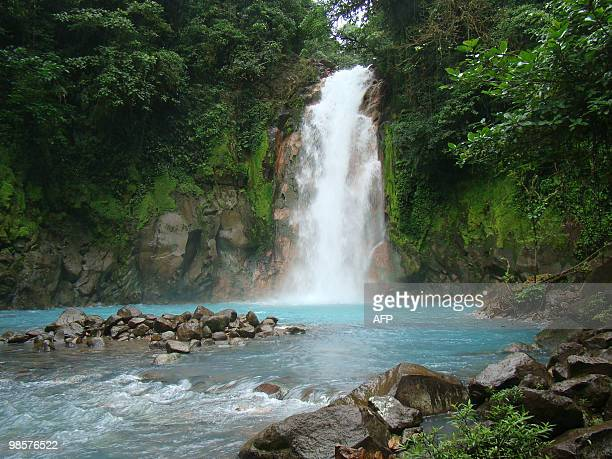 Picture of a waterfall along the course of the Celeste River in Costa Rica's Tenorio Volcano National Park taken on April 18 2010 The river gets its...