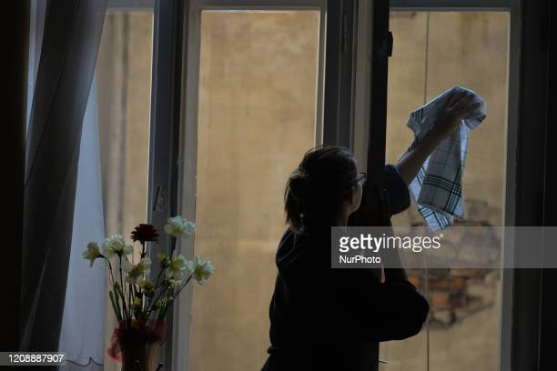 Picture of a woman cleaning her appartment window during the coronavirus lockdown in Krakow. On Wednesday, April 1 in Krakow, Poland.