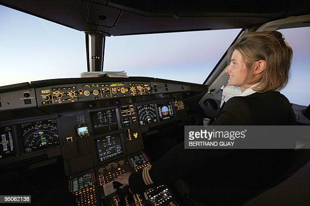Picture of a woman copilot taken in a cockpit aboard an Air France Airbus A 320 during a special flight from Paris to Seville to attend the first...