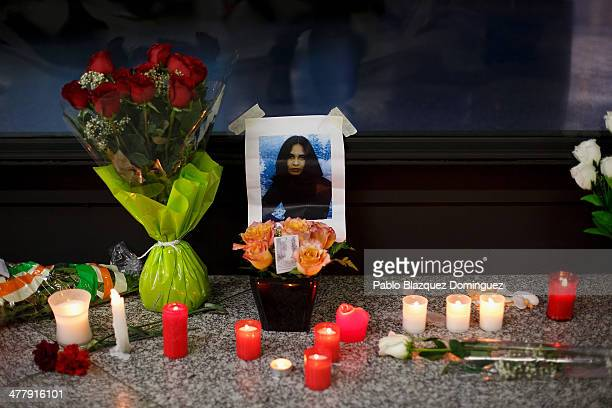 A picture of a woman on display next to candles letters and flowers placed for the victims of Madrid train bombings outside a memorial monument at...