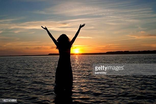 a picture of a woman on the beach - baptism stock pictures, royalty-free photos & images