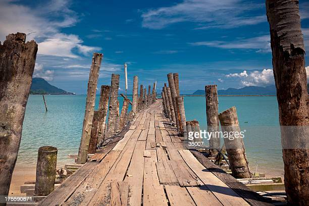 A picture of a wooden bridge on the beach