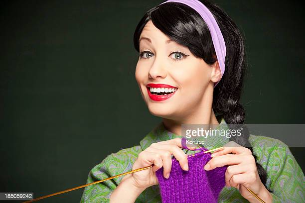 A picture of a young woman knitting