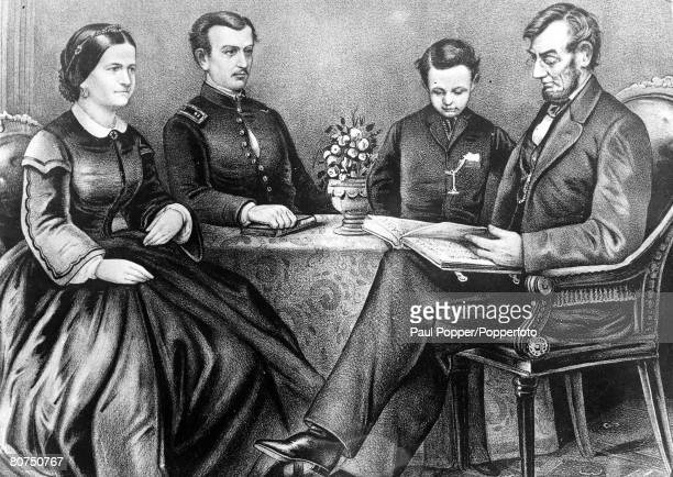 A picture of Abraham Lincoln the President of the United States from 186065 reading the bible to members of his family LR Mrs Lincoln his son Robert...