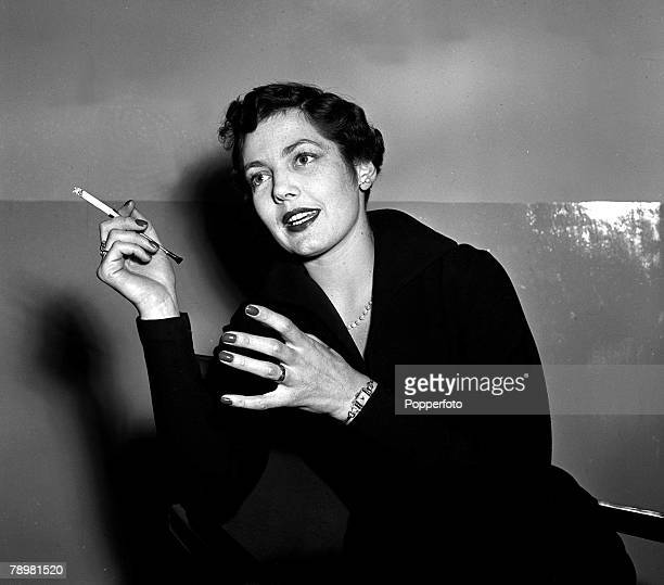 1952 A picture of Actress Diane Hart smoking a cigarette