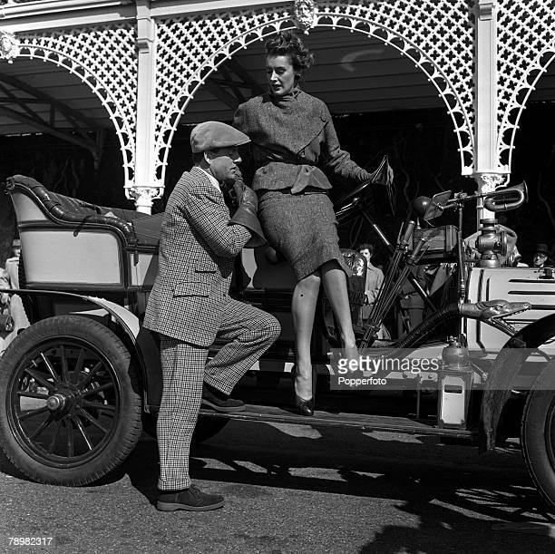 1952 A picture of actress Kay Kendall and British actor Kenneth Moore pictured in an old Crock Car on the set of the film 'Genevieve'