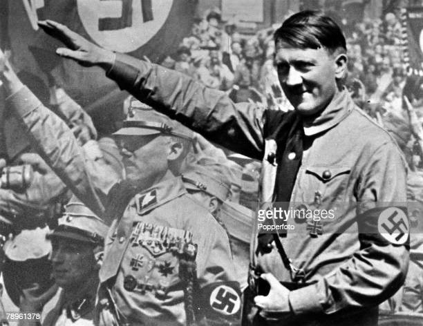 A picture of Adolf Hitler the German fascist dictator pictured saluting at a Nuremberg rally 1934
