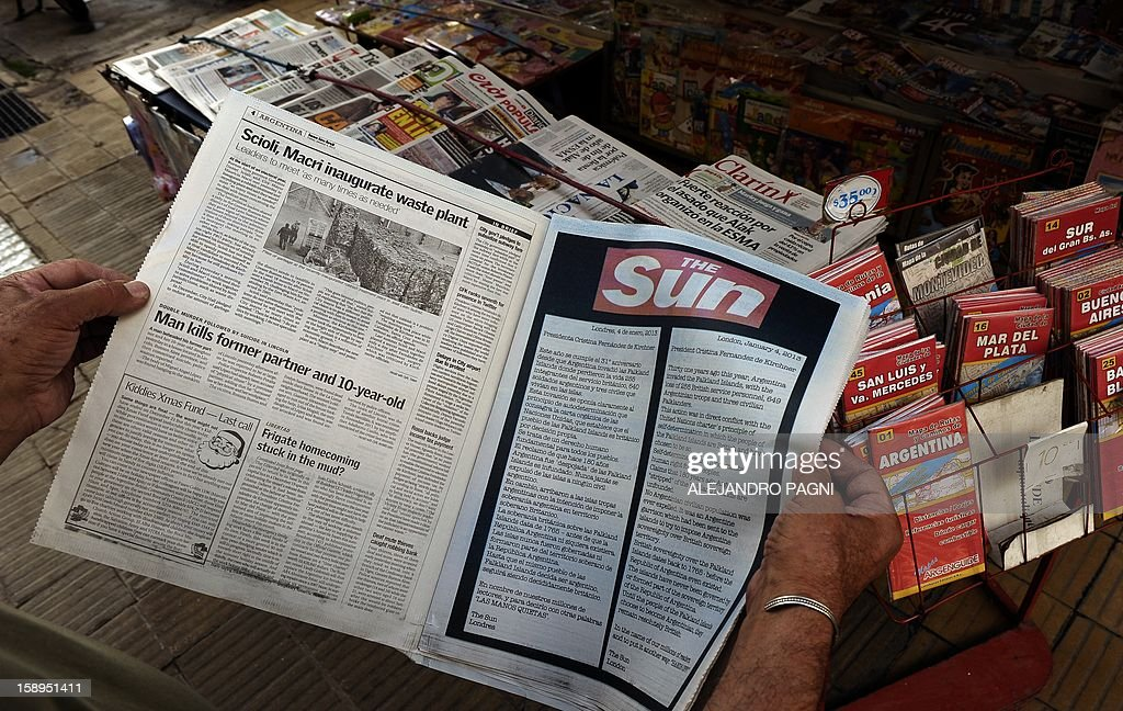 Picture of an advert placed in the Buenos Aires Herald by Britain's biggest-selling tabloid The Sun warning Argentina to keep its 'hands off' the Falklands, taken at a newsstand in San Telmo neighbourhood in Buenos Aires, on January 4, 2013. The Sun hit back at Argentina's President Cristina Fernandez de Kirchner's renewed claim over the disputed Falkland Islands in an open letter to her in the Buenos Aires Herald newspaper on Friday, a day after Fernandez de Kirchner published her own open letter in two British newspapers urging Britain to give up the South Atlantic islands.