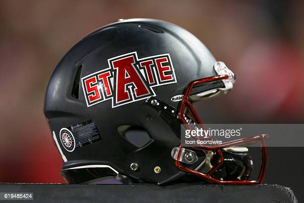 Picture of an Arkansas State University football helmet resting on an equipment cabinet during the game between the Arkansas State Red Wolves and the...