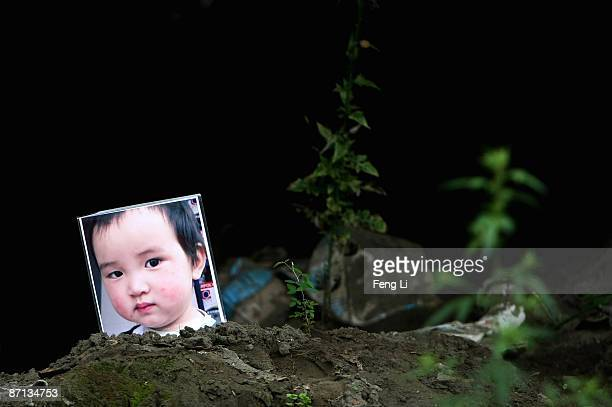A picture of an earthquake victim is seen at the ruins of earthquakehit Beichuan county during the one year anniversary of the Wenchuan Earthquake on...