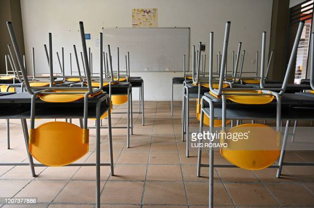 Picture of an empty classroom at the Eustaqui Palacios school in Cali, Colombia, taken on March 16 after the Colombian government announced the...